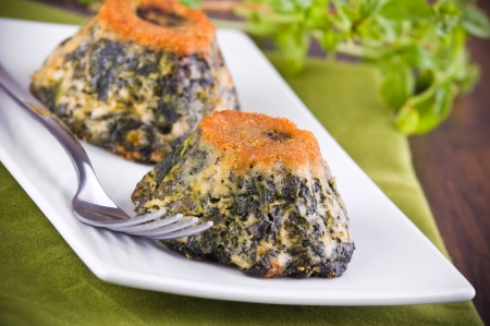 Spinach cakes on white dish