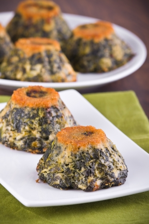 Spinach cakes on white dish  photo