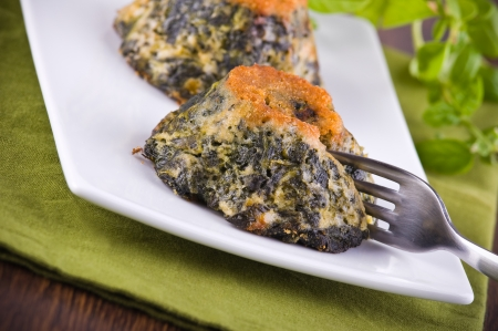 speciality: Spinach cakes on white dish