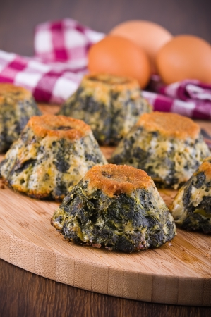 speciality: Spinach cakes on wooden cutting board