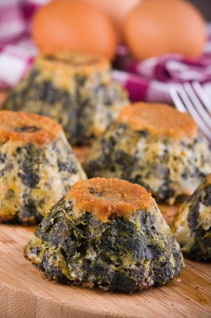 Spinach cakes on wooden cutting board  Stock Photo - 15657018