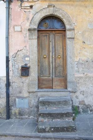 Wooden door. Soriano nel Cimino. Lazio. Italy.  photo