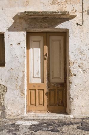 Wooden door. Gallipoli. Puglia. Italy. photo