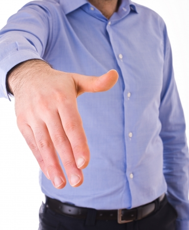 concordance: Young business man giving hand. Stock Photo