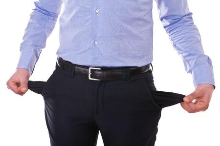 beroofd: Jonge zakenman te trekken uit lege zakken.