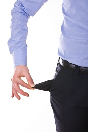 empty pocket: Young business man pulling out empty pocket.