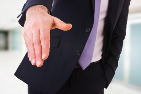 stipulation: Business man giving hand  Stock Photo