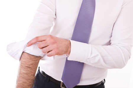 rolling up: Business man rolling up sleeves