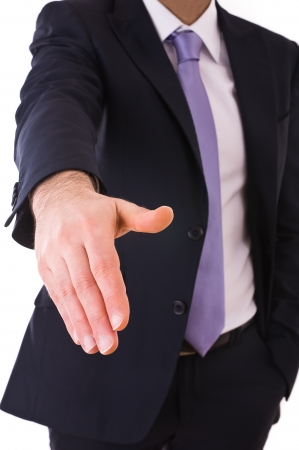 stipulation: Business man giving hand. Stock Photo