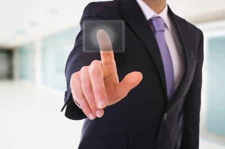 Businessman touching button