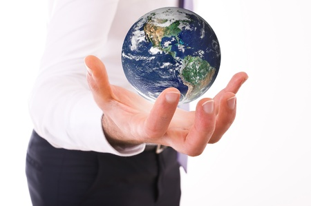 Business man carrying earth  photo