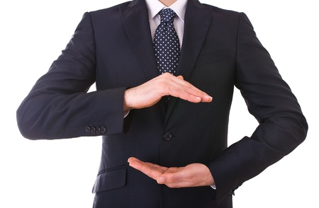 cupped hands: Business man with cupped hands as if holding something. Stock Photo