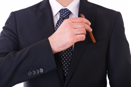 professionalism: Businessman putting a pen in his pocket