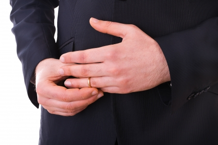 deceitful: Business man taking off his wedding ring