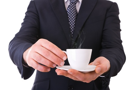Business man offering cup of coffee  photo