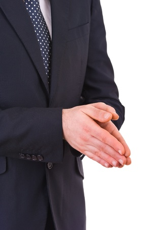 impatience: Businessman rubbing his hands together.