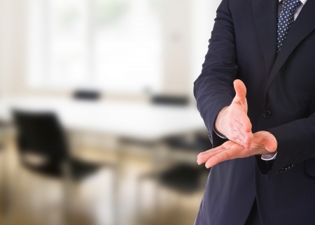 decisive: Businessman gesturing with both hands