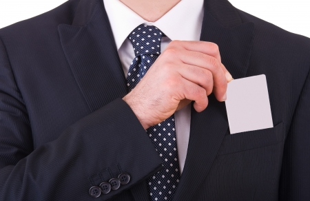 Businessman putting blank card in his pocket  photo