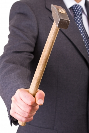 Businessman with hammer. photo