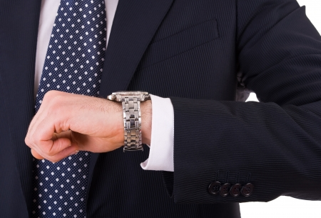 checking the time: Businessman checking time on his wristwatch. Stock Photo