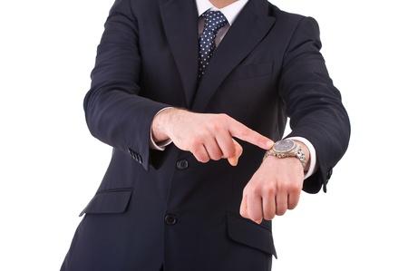 haste: Businessman pointing at his wristwatch.