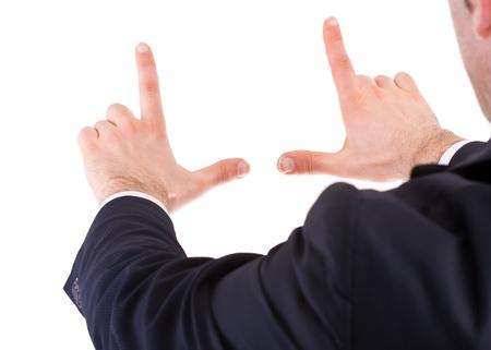 Uomo d'affari di una cornice con le sue mani