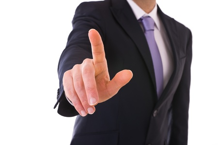 Businessman touching an imaginary screen  Stock Photo - 18859873