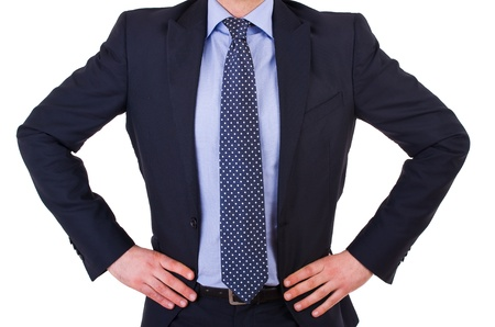 Businessman with hands on his hips  photo
