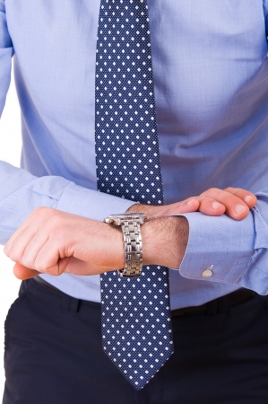 Businessman checking time on his wristwatch  photo