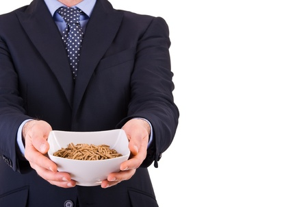 Businessman offering a cereal bowl  photo