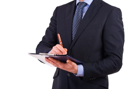 Businessman writing notes on clipboard. photo