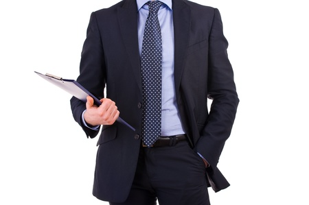Businessman holding a clipboard. photo