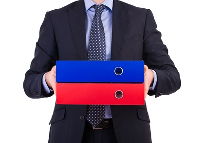 Businessman holding folders. photo