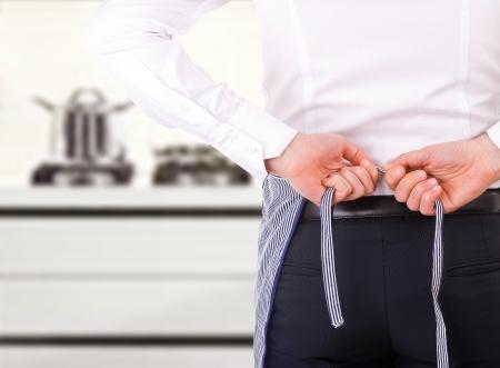 Businessman tying apron strings