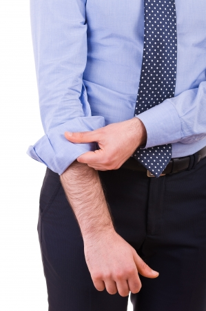 Businessman rolling up his shirt sleeves Imagens - 19027611
