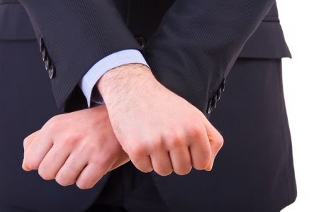 Businessman showing jail gesture with his hands  Stock Photo - 19027600