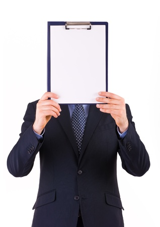 Businessman showing clipboard. photo