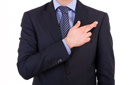 swearing: Business man with fingers crossed