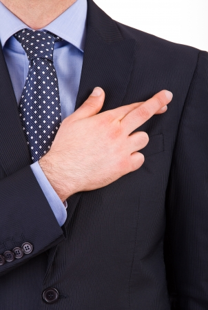 allegiance: Business man with fingers crossed