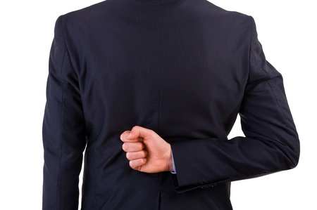 Businessman with his hand behind his back. photo