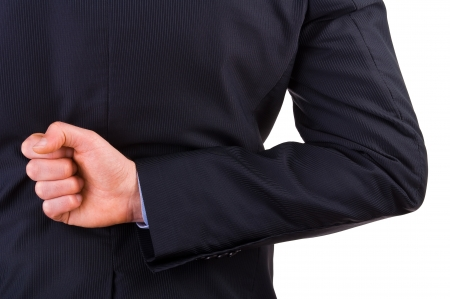 Businessman with his hand behind his back. Stock Photo - 19031892