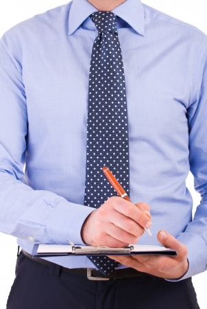 Businessman with pen and clipboard. photo