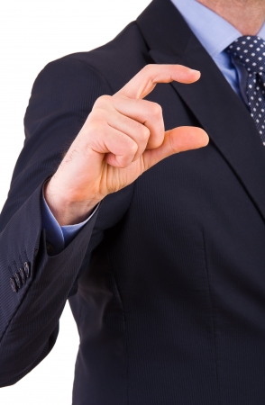 Businessman gesturing small size with fingers. photo