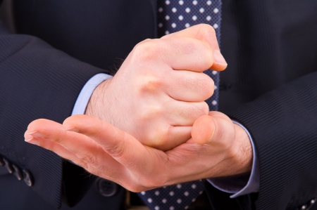 Businessman gesturing with both hands. photo