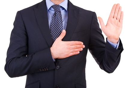 promise: Businessman taking oath. Stock Photo