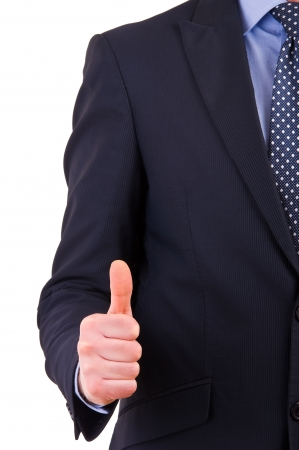 Business man showing thumbs up sign. photo