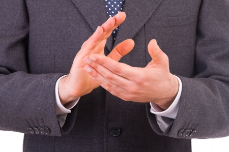 acclamation: Businessman clapping his hands
