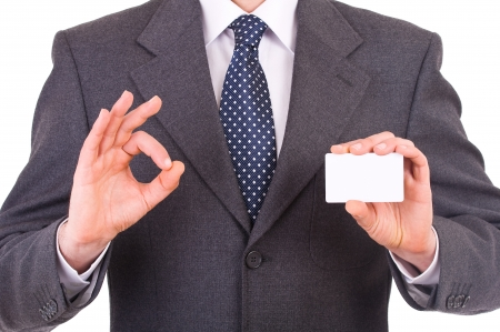 Business man showing blank card. photo