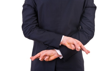 scepticism: Business man with fingers crossed