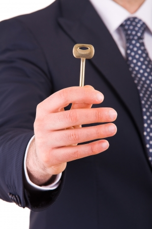 Businessman holding key  photo